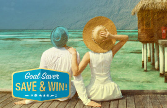 Savings goals guide, couple wearing hats sitting on a tropical ocean boardwalk, overlay text reads goal saver save and win