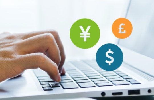 Premier, international payments, hands typing on laptop, yen, dollar and pound currency symbols in separate coloured circles
