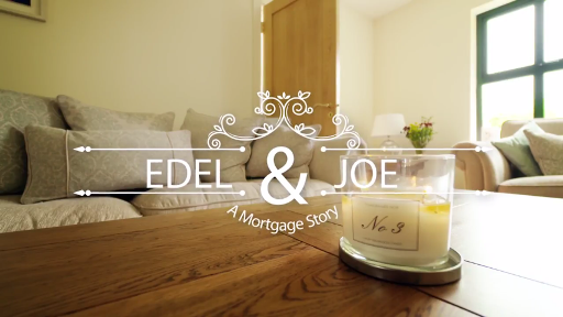 Mortgage manager, candle on a coffee table in a sitting room, overlay text reads a mortgage journey, Edel and Joe