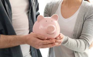 Couple holding piggy bank savings