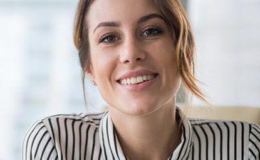 Female mortgage specialist smiling in an office