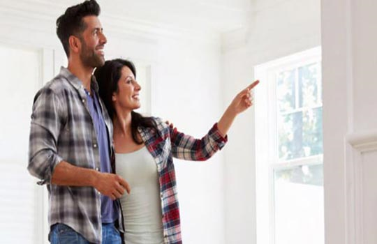 Couple pointing at inside wall of self build home